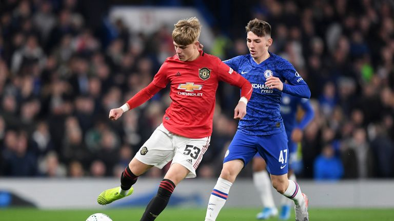 Brandon Williams of Manchester United is challenged by Chelsea's Billy Gilmour