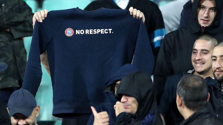 A Bulgaria supporter holds up a sweatshirt with the words No Respect displayed across the chest during the game against England