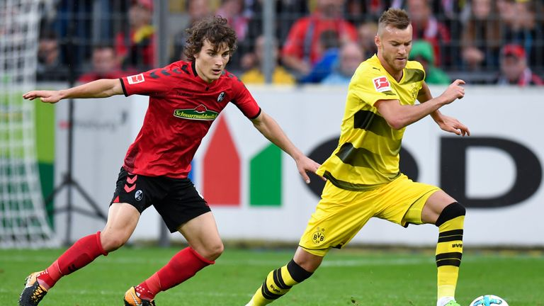 Caglar Soyuncu in action for Freiburg against Borussia Dortmund