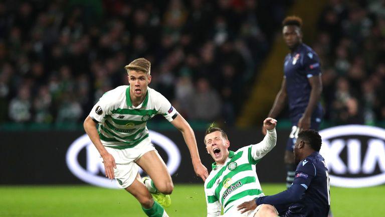 Celtic's Callum McGregor is fouled by Lazio's Bastos