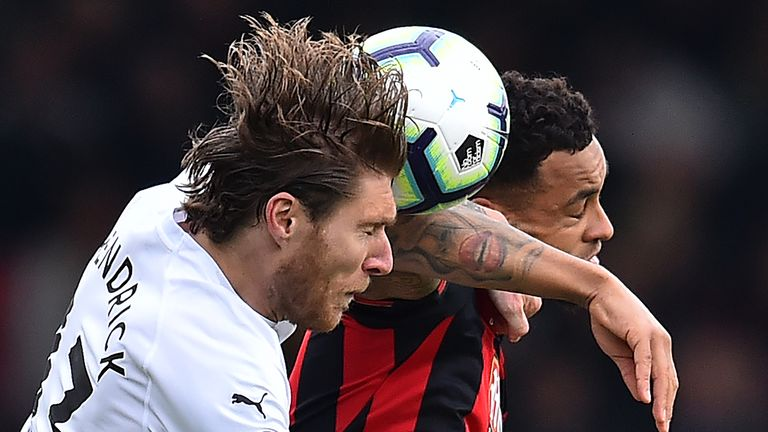 Bournemouth's Callum Wilson and Burnley's Jeff Hendrick contest an aerial battle