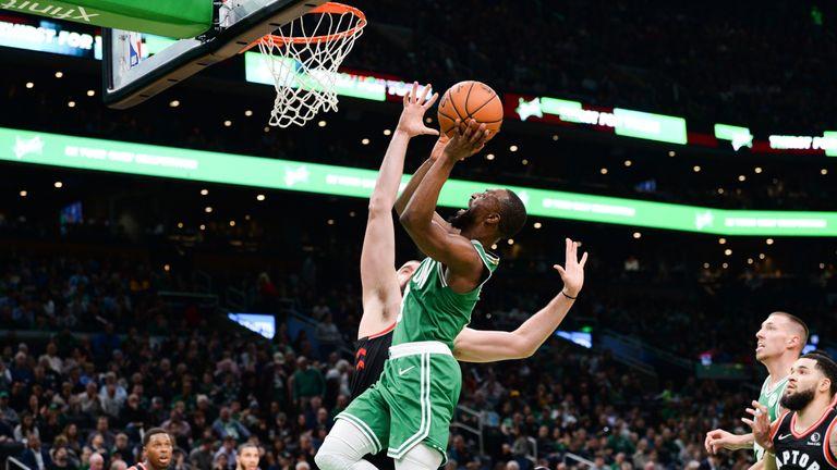 Kemba Walker of the Boston Celtics drives to the basket against Marc Gasol of the Toronto Raptors
