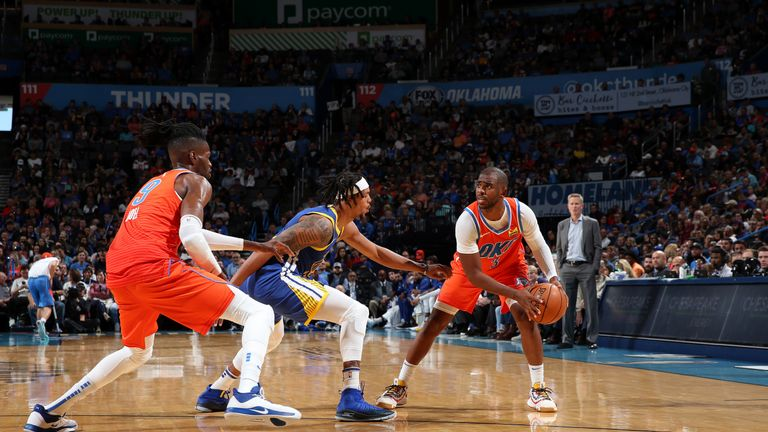Chris Paul of the Oklahoma City Thunder handles the ball against the Golden State Warriors