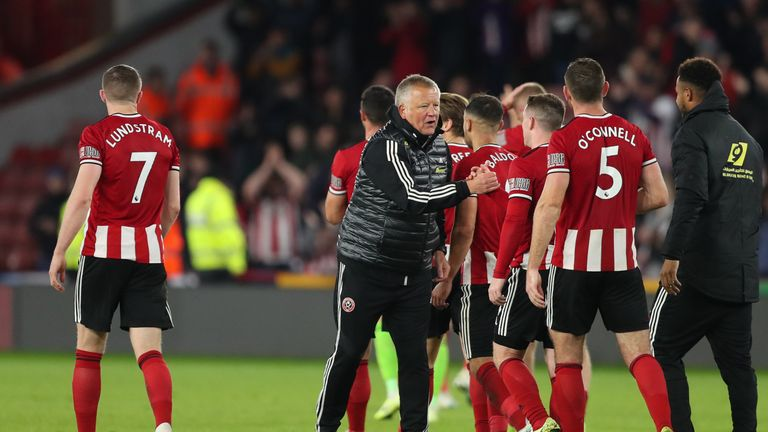 Chris Wilder and his players celebrate the Blades' 1-0 win against Arsenal