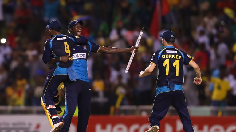 Gurney celebrates winning the Carribean Premier League with Barbados Tridents teammates Shai Hope and Jason Holder