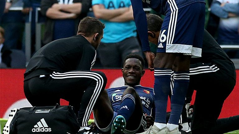 Danny Welbeck receives treatment after going down injured