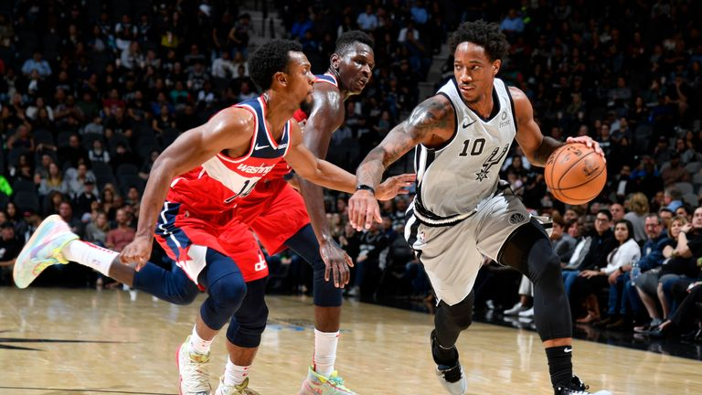 DeMar DeRozan of the San Antonio Spurs handles the ball against the Washington Wizards