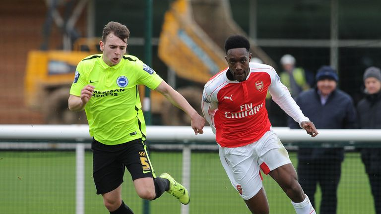 Hutchinson in action against Danny Welbeck during an U21 Premier League game