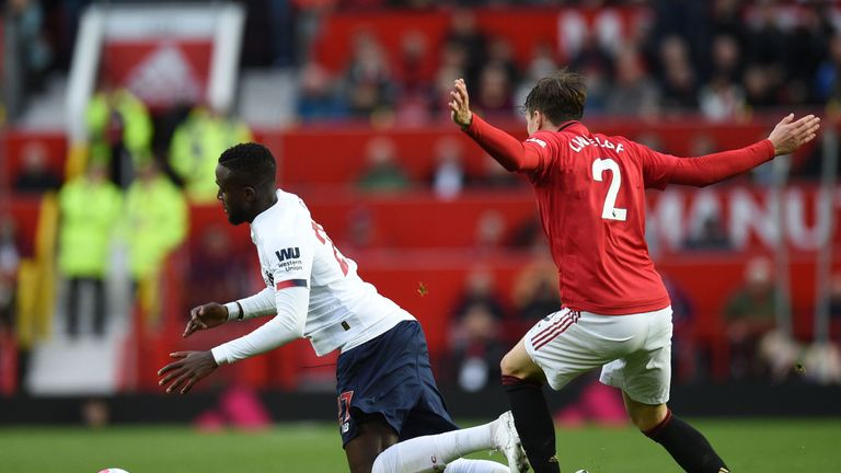 Victor Lindelof's challenge on Divock Origi was waved away by Martin Atkinson