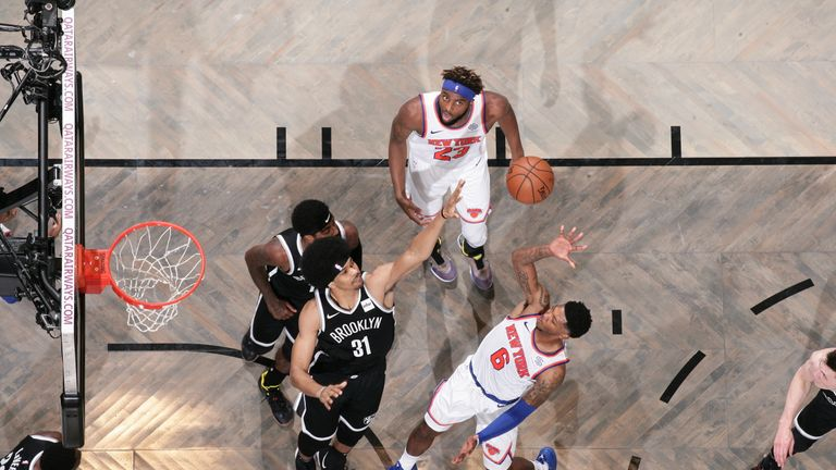 Elfrid Payton of the New York Knicks shoots the ball against the Brooklyn Nets