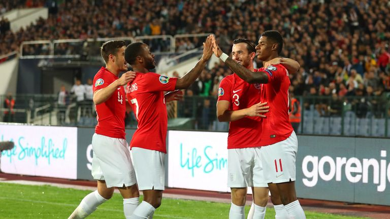 The England players celebrated one of their six goals against Bulgaria