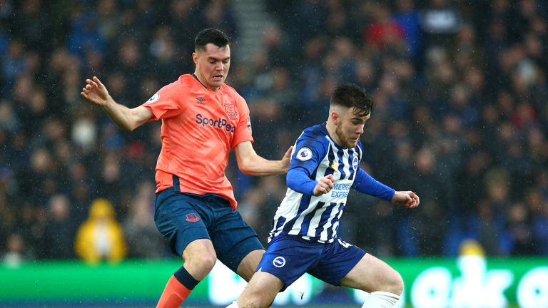 Aaron Connolly attempts to get away from Michael Keane