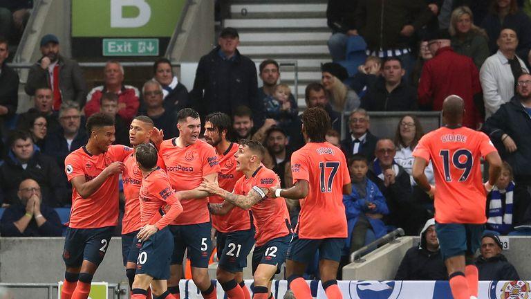Everton players celebrate their equaliser at Brighton