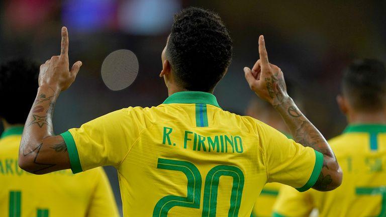 Roberto Firmino celebrates opening the scoring against Senegal