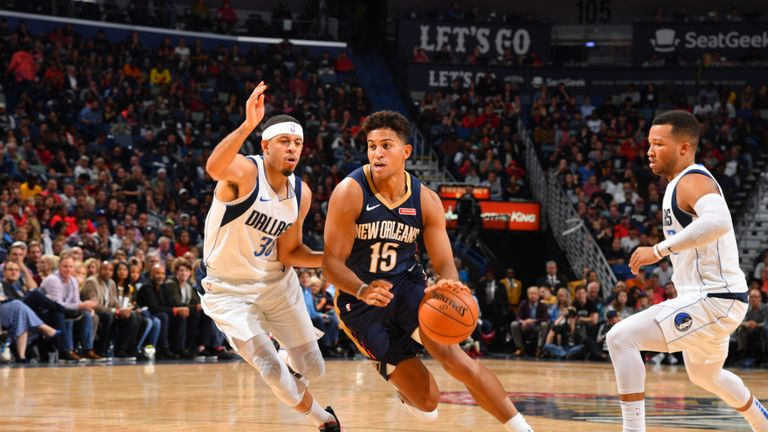 Frank Jackson of the New Orleans Pelicans handles the ball against the Dallas Mavericks