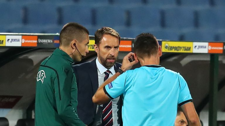 Southgate talks to the referee during England's win over Bulgaria