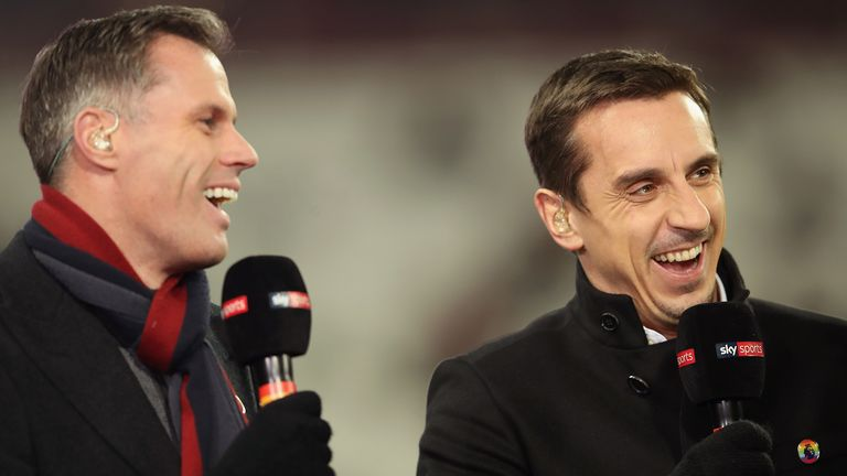 Pundits Jamie Carragher (L) and Gary Neville laugh prior to the Premier League match between West Ham United and Leicester City at London Stadium on November 24, 2017 in London, England.