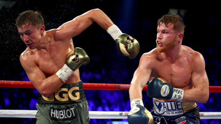 (L-R) Canelo Alvarez throws a punch at Gennady Golovkin during their WBC, WBA and IBF middleweight championionship bout at T-Mobile Arena on September 16, 2017 in Las Vegas, Nevada.