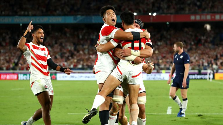 Japan players celebrate their third try en route to victory
