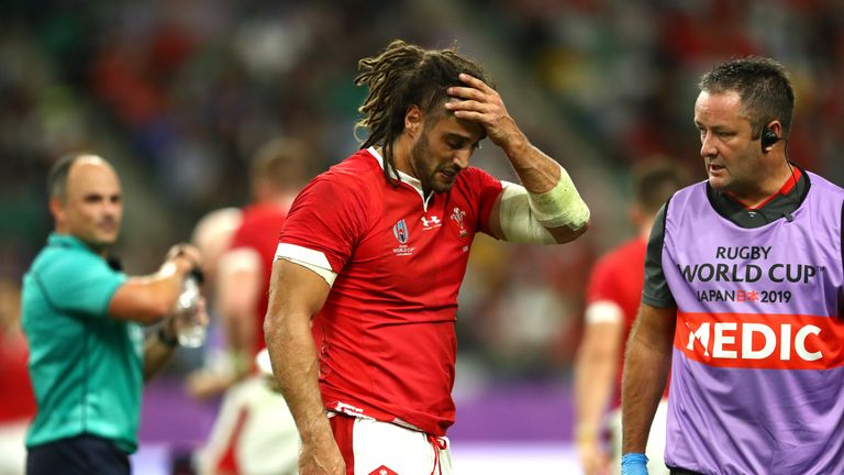Josh Navidi of Wales receives medical attention during the Rugby World Cup 2019 Quarter Final match between Wales and France at Oita Stadium on October 20, 2019 in Oita, Japan