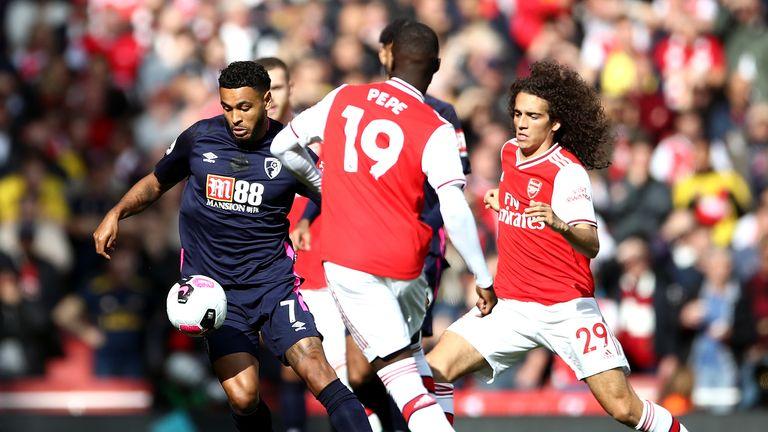 Joshua King battles for possession with Nicolas Pepe and Matteo Guendouzi