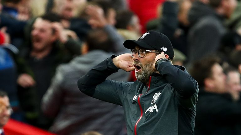 Jurgen Klopp cups his ears in celebration during the Premier League match between Liverpool and Leicester City at Anfield