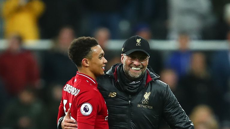 Trent Alexander-Arnold of Liverpool and Jurgen Klopp manager / head coach of Liverpool celebrate at full time during the Premier League match between Newcastle United and Liverpool FC at St. James Park on May 4, 2019 in Newcastle upon Tyne, United Kingdom.