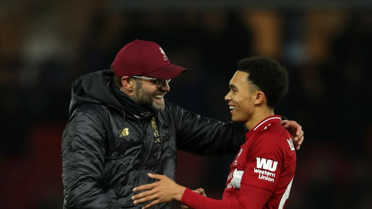 Jurgen Klopp, Manager of Liverpool congratulates scorer of the second goal, Trent Alexander-Arnold following the Premier League match between Watford FC and Liverpool FC at Vicarage Road on November 24, 2018 in Watford, United Kingdom. (