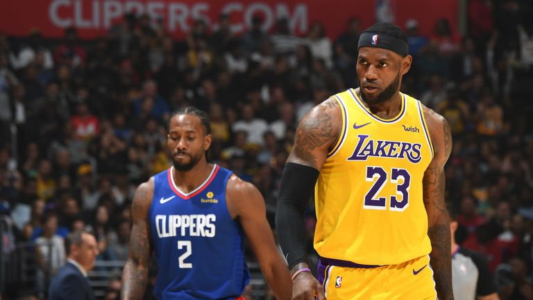 Lakers' LeBron James and Clippers' Kawhi Leonard in action at the Staples Center