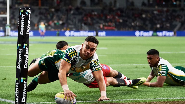 Kayal Iro dives over for one of his two tries in the Cook Islands' win over Tonga