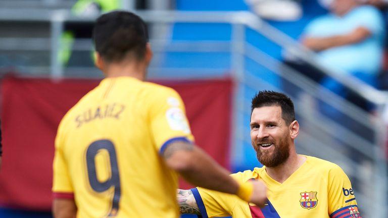 Lionel Messi celebrates making it 2-0 for Barcelona against Eibar on Saturday
