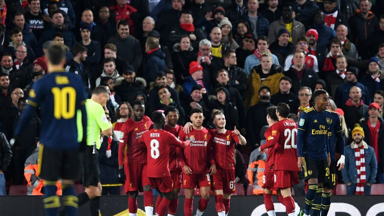Liverpool players celebrate after Shkodran Mustafi's own-goal gives them a 1-0 lead