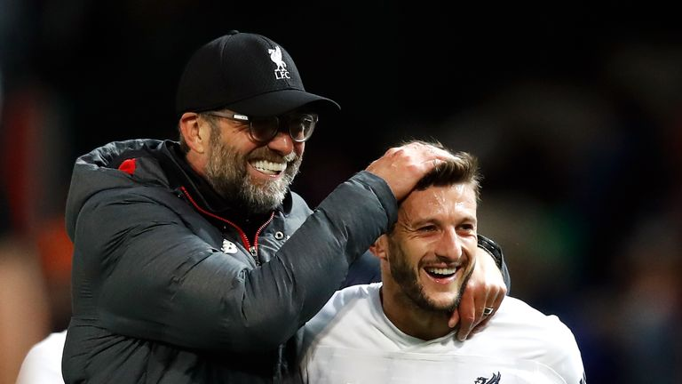 Jurgen Klopp celebrates with Adam Lallana