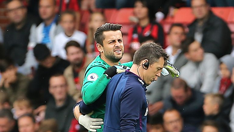 Lukasz Fabianski leaves the pitch with an injury at Bournemouth