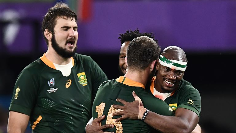 Makazole Mapimpi and Willie Le Roux celebrate after the win over Italy
