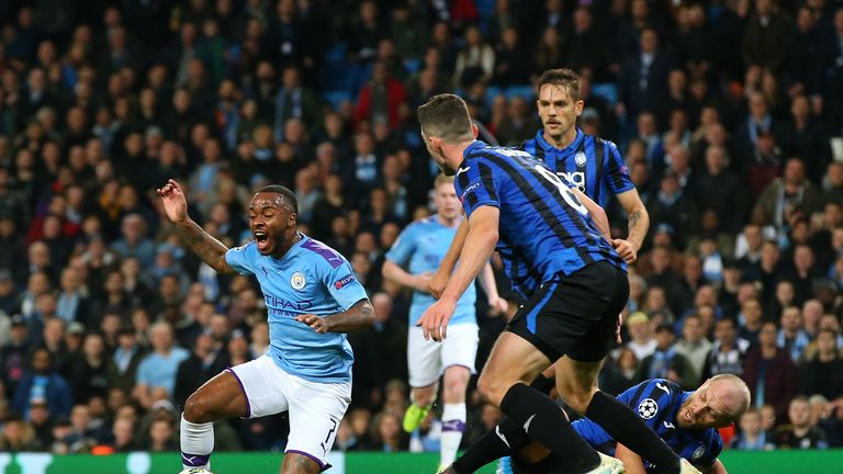 Raheem Sterling goes down inside the box to give City the chance to make it 2-1