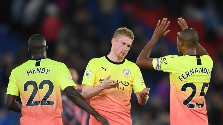 Kevin De Bruyne of Manchester City celebrates victory at Crystal Palace with Fernandinho and Benjamin Mendy