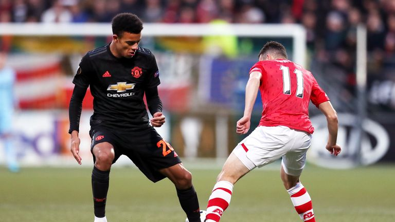 Mason Greenwood loses out in a tackle against AZ Alkmaar