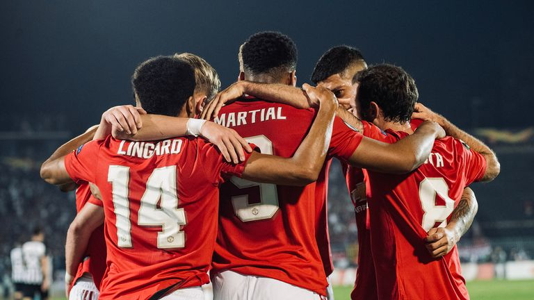 Manchester United players celebrate Anthony Martial's opener against Partizan Belgrade