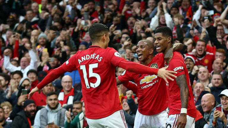 Marcus Rashford celebrates his opening goal against Liverpool