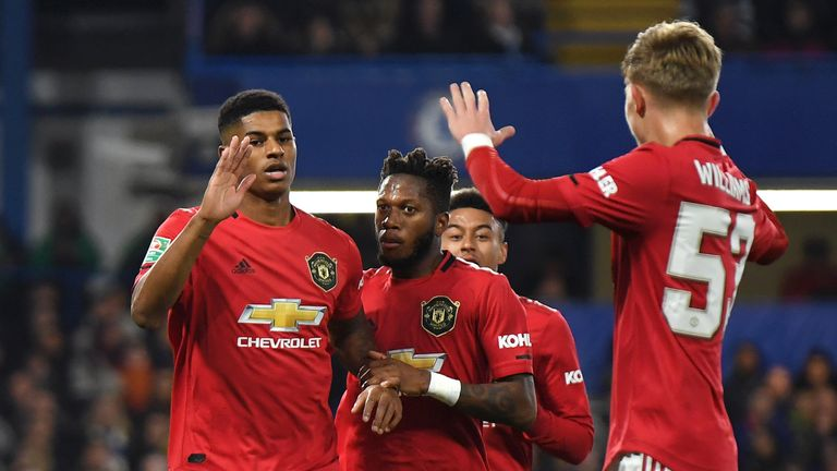 Marcus Rashford celebrates after scoring his penalty to put Manchester United ahead