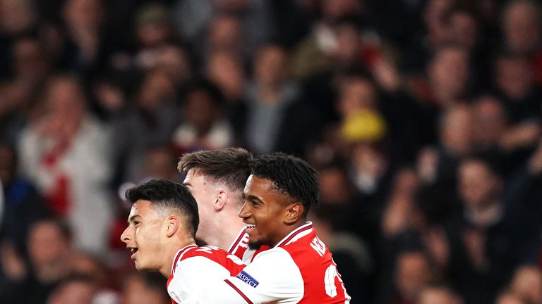 Gabriel Martinelli is embraced by Reiss Nelson