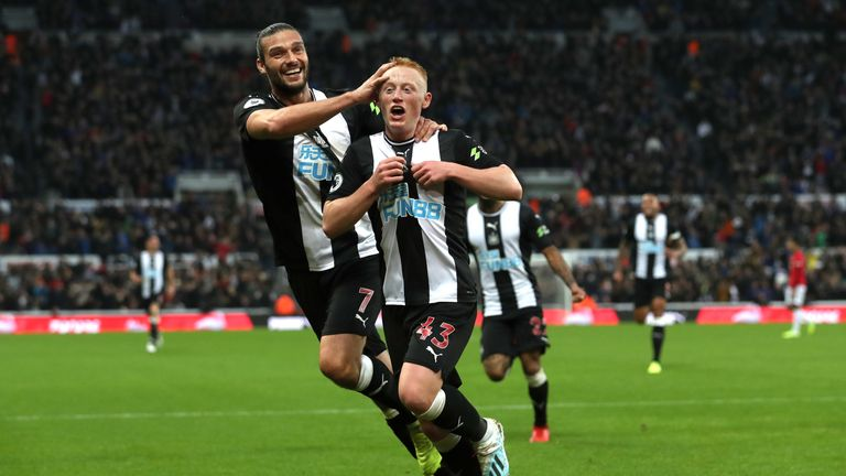 Matty Longstaff of Newcastle United celebrates his opener against Manchester United with team-mate Andy Carroll