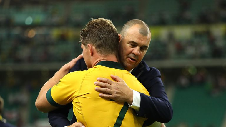 Michael Cheika, Head Coach of Australia and Michael Hooper embrace after their loss to England