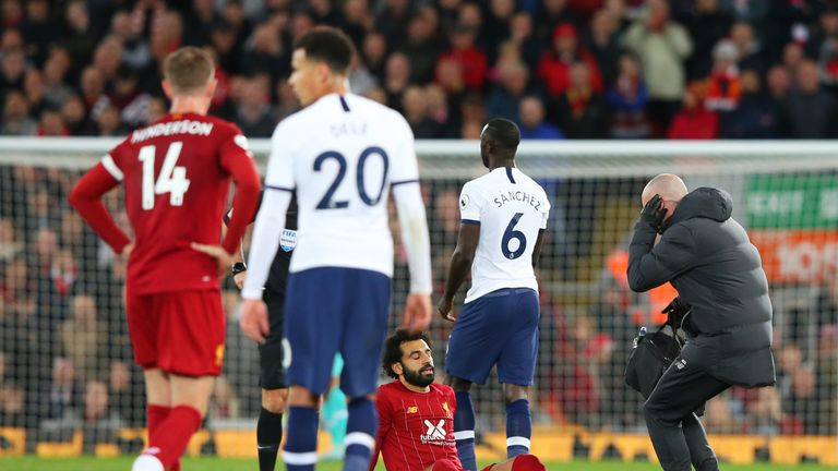 Mohamed Salah goes down with an injury at Anfield
