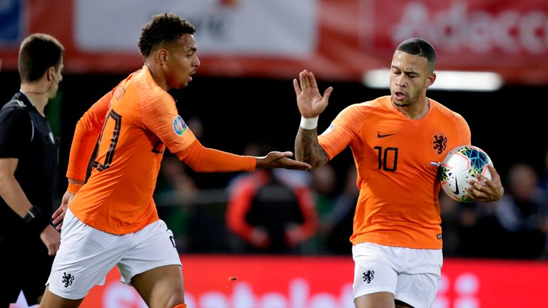 Depay celebrates a goal for the Netherlands
