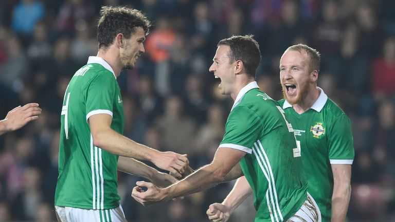 Northern Ireland's defender Jonny Evans (c) celebrates with his teammates after scoring during the international friendly football match between Czech Republic and Northern Ireland in Prague, on October 14, 2019. (Photo by Michal CIZEK / AFP) (Photo by MICHAL CIZEK/AFP via Getty Images)