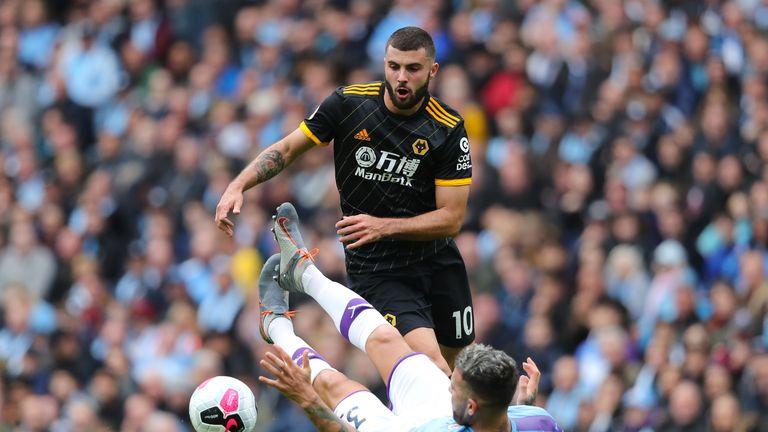 Patrick Cutrone of Wolves runs at Manchester City's Nicolas Otamendi