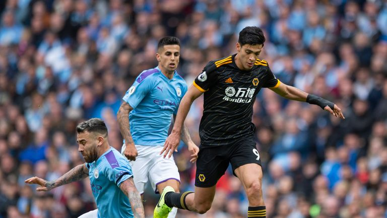 MANCHESTER, ENGLAND - OCTOBER 06: Raul Jimenez of Wolverhampton Wanderers skips past Nicolas Otamendi of Manchester City during the Premier League match between Manchester City and Wolverhampton Wanderers at Etihad Stadium on October 6, 2019 in Manchester, United Kingdom. (Photo by Visionhaus) *** Local Caption *** Raul Jimenez; Nicolas Otamendi