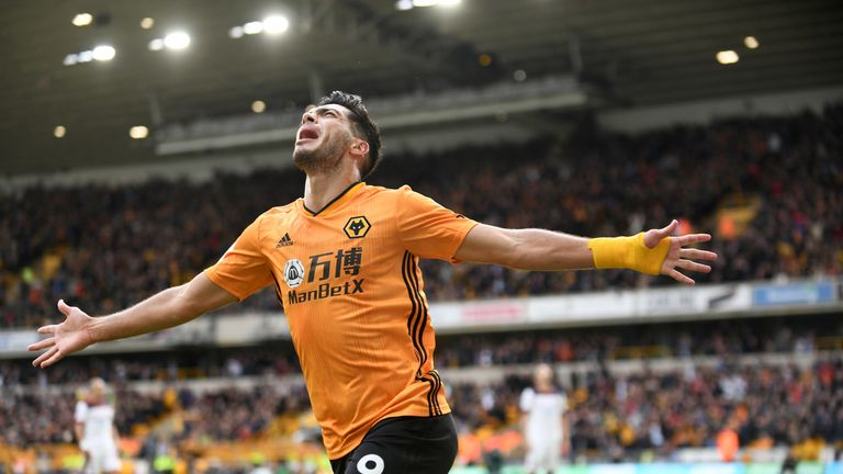 Raul Jimenez celebrates with arms outstretched after converting his penalty